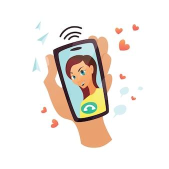 손 디스플레이에 웃는 여자의 얼굴로 휴대 전화를 들고있다.