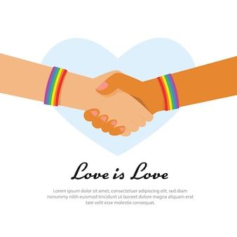 Mano di lgbt che tiene insieme al simbolo del nastro arcobaleno