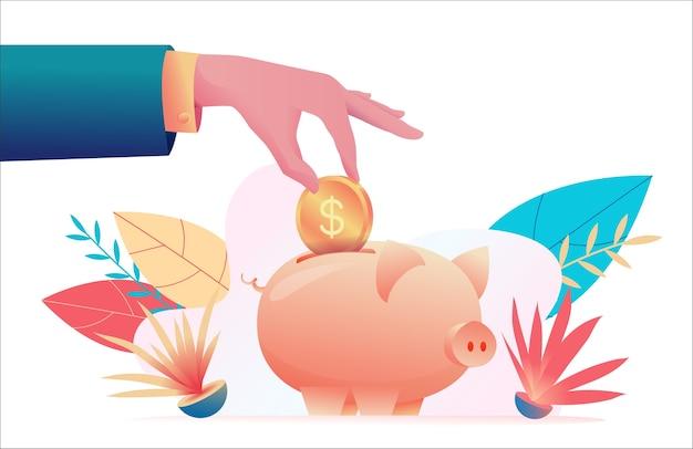 사업가의 손에 돼지 저금통에 동전을 넣습니다.