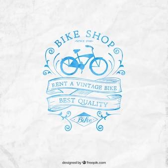 Hand painted bike shop logo