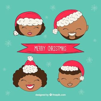 크리스마스에 손으로 그린 가족 얼굴
