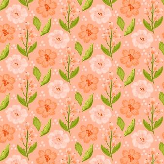 손으로 복숭아 톤의 꽃 패턴을 그린