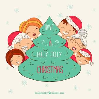 크리스마스 트리 주위에 손으로 그린 행복 한 가족