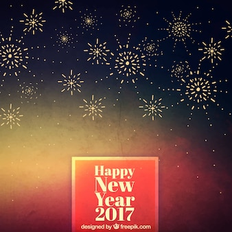 Hand painted new year on a background with fireworks