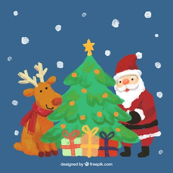Hand painted reindeer, santa claus and a christmas tree Free Vector