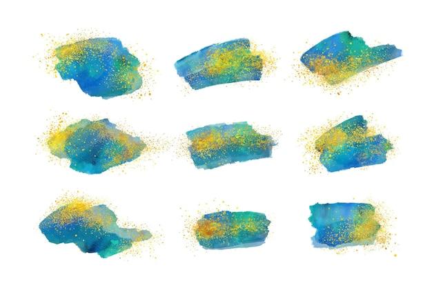 Collezione di pennellate ad acquerello dipinto a mano con oro e glitter