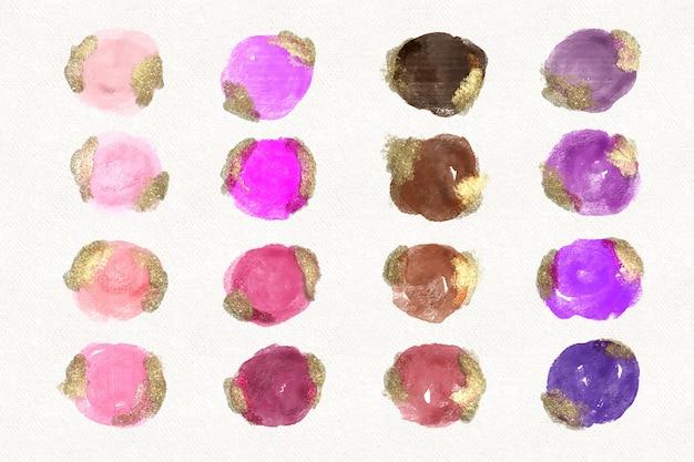 손으로 금과 반짝이로 수채화 얼룩을 그린