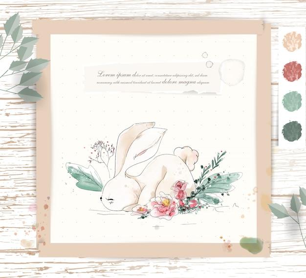 手描きの熱帯の花と葉の枝に水彩の熱帯のかわいい動物のウサギ