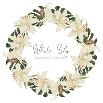 モンステラと手描きの白いユリの花のフレーム