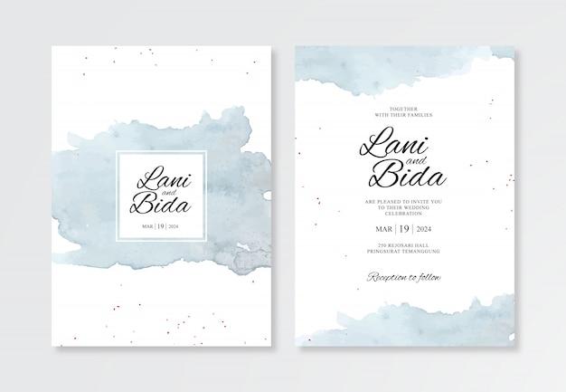 美しい結婚式のカードの招待状のテンプレートの水彩スプラッシュを描く手