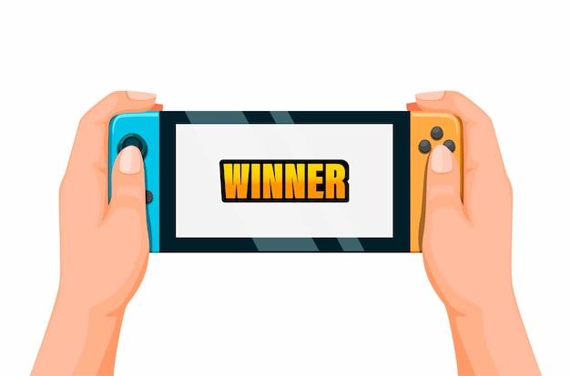勝者のシンボルでポータブルゲームをプレイする手