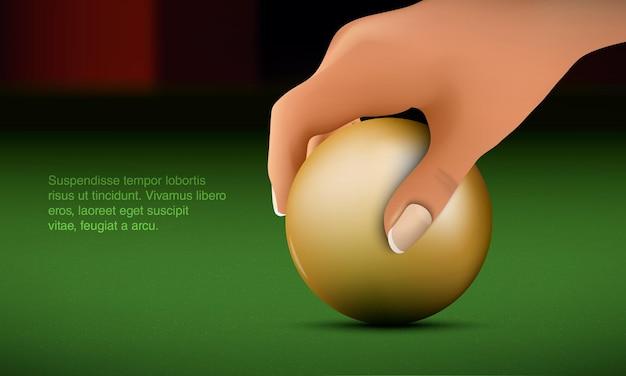 Рука кладет шар на бильярдный стол.