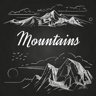 手が黒板に山の風景をスケッチ