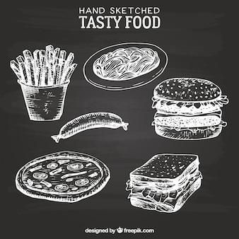 手はおいしい食べ物をスケッチ