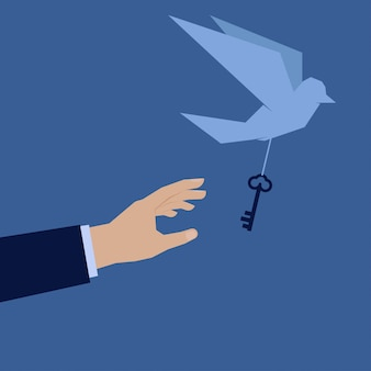 Hand try to catch the bird take key of success away.