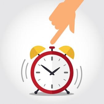 Hand turns off red alarm clock