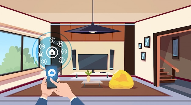 Hand using smart home app interface of control panel over living room interior modern technology of house monitoring concept