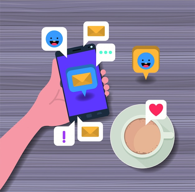 Hand using smartphone with coffee cup and social icons