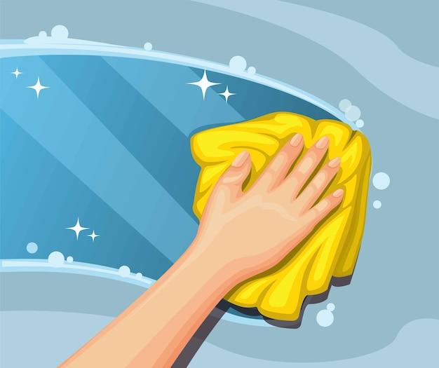 더러운 유리를 닦는 손