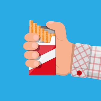 Hand with cigarette package
