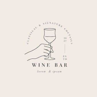 Hand with a glass of drink. abstract logo for cafe or bar.