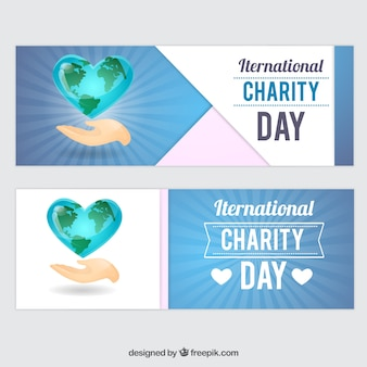 Hand with heart banners of charity day