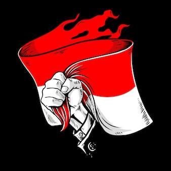 インドネシアの旗を手に
