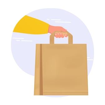 紙袋を持って手渡し、レストランの店から自宅への安全で清潔な食品の配達。配信のコンセプト。