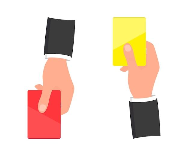 빨간색과 노란색 카드와 손입니다. 축구의 빨간색과 노란색 카드입니다. 축구 심판 손