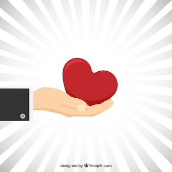 Hand with a red heart background