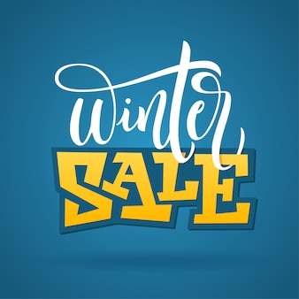 Hand written winter phrase - winter sale. typography poster  on blue background.  illustration for banners, flyers, broshures, ads.