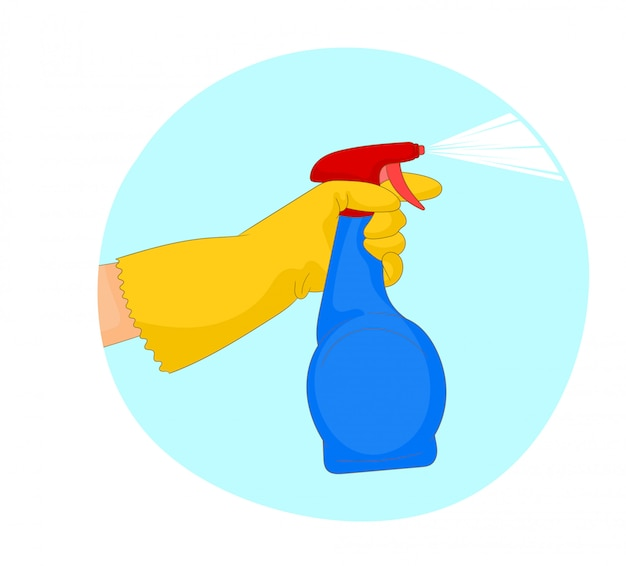 A hand in a yellow glove holds a spray of cleaning fluid