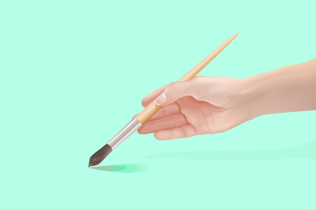 Hand of young girl holding paintbrush