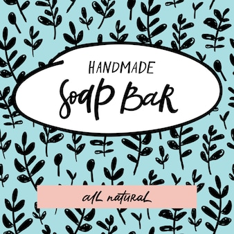 Handmade soap bar label with handdrawn lettering and floral seamless pattern