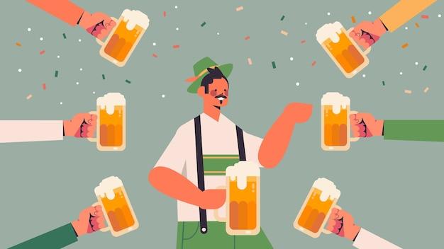 Hands around man holding beer mugs
