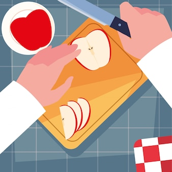 Hands of chef with knife and kitchen board