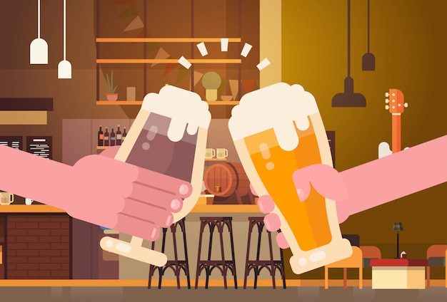 Hands clinking beer people in pub or bar restaurant cheering party celebration festival concept