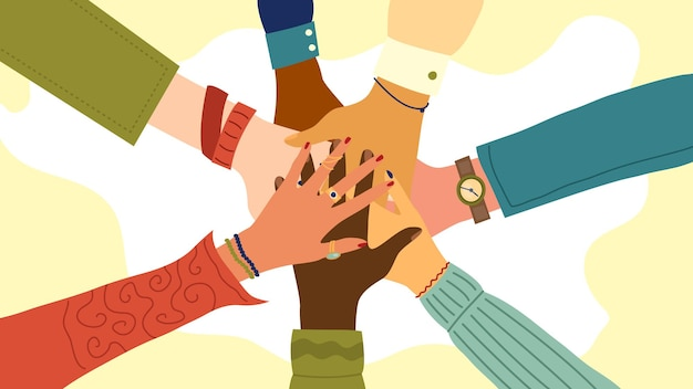 Hands of diverse group of people putting together.