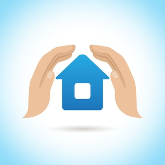 Hands hold home. home insurance concept