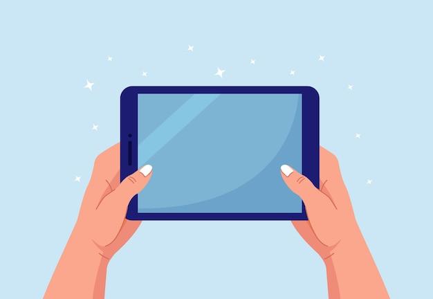 デジタルタブレットpcを持って指さしている手。タブレットコンピュータの空白の画面に触れる男
