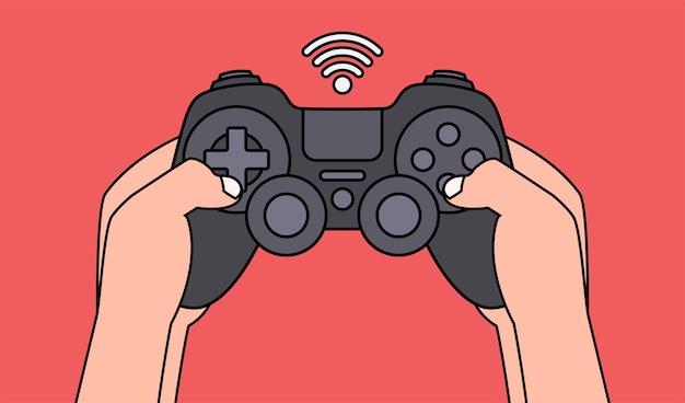 黒のゲームパッドを押しながらビデオゲームをプレイする手。図。