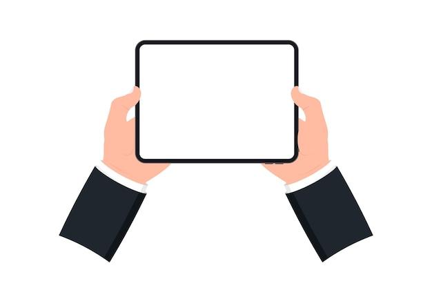 흰색 바탕에 빈 화면이 있는 검은색 태블릿을 들고 있는 손. 디지털 태블릿과 손가락 터치 스크린을 사용하는 인간의 손. 빈 화면이 있는 템플릿 모형 태블릿 pc입니다. 웹사이트, 모바일 앱용 디자인