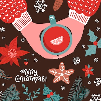 Hands holding cup with mulled wine top view . christmas hot drink creative flat lay. xmas elements flatlay. greetong cars with lettering quote. red punch in mug.