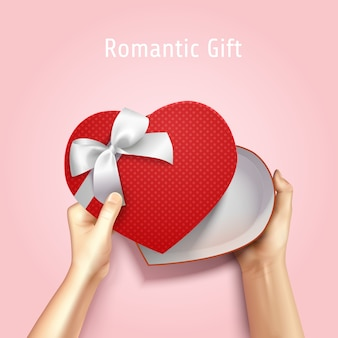 Hands holding gift box top view realistic 3d composition with heart shaped carton and editable text