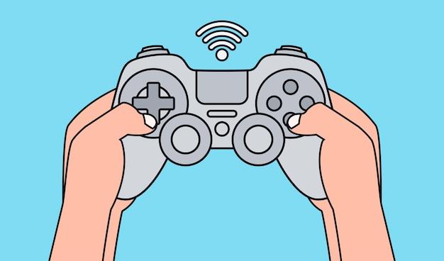 灰色のゲームパッドを押しながらビデオゲームをプレイする手。図。