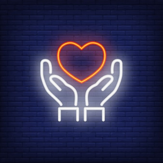 Hands holding heart neon sign