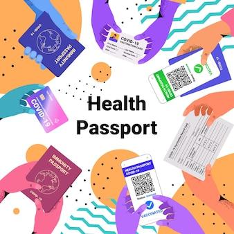 Hands holding international certificates of vaccination digital immunity passportson risk free covid-19 pandemic