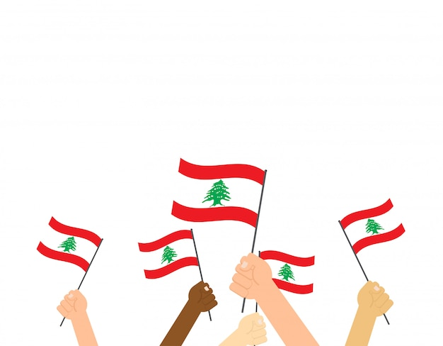 Hands holding lebanon flags