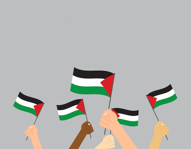 Hands holding palestine flags