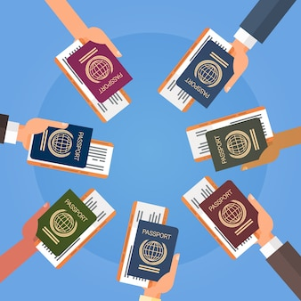 Hands holding passport ticket boarding pass travel document